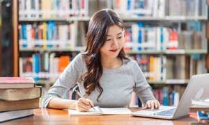Asian young Student in casual suit doing homework